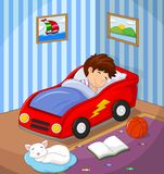 The boy was asleep in the car bed Stock Images