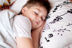 Boy was asleep on pillow with Chinese characters Stock Photography