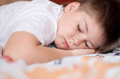 Boy was asleep on pillow with Chinese characters Stock Photos
