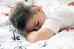 Boy was asleep on pillow with Chinese characters Stock Images