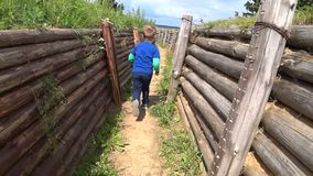 The boy was lost in the trench maze, running through the trench stock footage