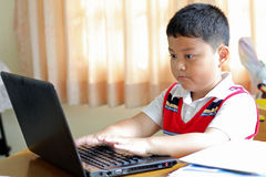 The boy was playing  notebook. Royalty Free Stock Photography