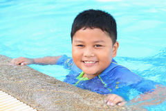 The boy was swimming Stock Photos