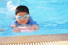 The boy was swimming in the pool. Royalty Free Stock Photography