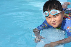 The boy was swimming in the pool. Royalty Free Stock Photos