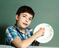 Boy wash plate to help mother close up portrait Royalty Free Stock Image