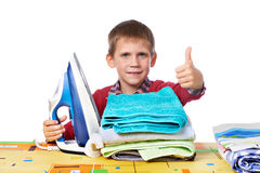 Boy with washed linen and iron isolated Stock Image