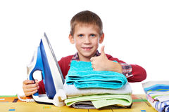 Boy with washed linen and iron isolated Royalty Free Stock Photo