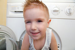Boy from washer Royalty Free Stock Photography