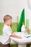 Boy washes Stock Photography
