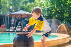 The boy washes the feet of the sand around the pool in Vietnam Stock Images