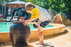 The boy washes the feet of the sand around the pool in Vietnam Royalty Free Stock Photos