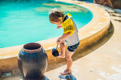 The boy washes the feet of the sand around the pool in Vietnam Stock Photography