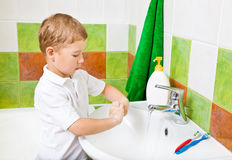 Boy washes with hand soap. Royalty Free Stock Photo
