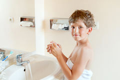 Boy washes hands Stock Photography
