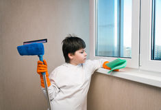 Boy washes a window Stock Photo