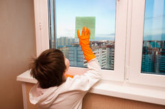 Boy washes a window Stock Image