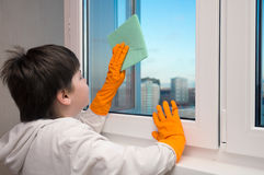 Boy washes a window Stock Photography