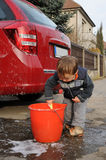 Boy washing car Stock Photos