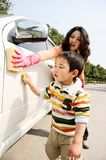 Boy washing car royalty free stock images