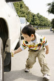 Boy washing car. A picture of a little chinese boy washing car hard and happily Stock Image