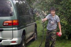 Boy washing car Royalty Free Stock Photography