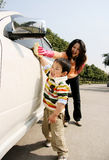 boy washing car with mother royalty free stock photo