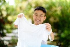 Boy washing cloth by his hand royalty free stock photography