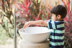 Boy washing hand at toilet park outdoor Stock Photo