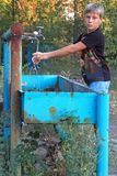 Boy is washing hands in outdoor wash basin Stock Photography