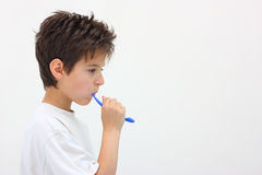 A boy washing teeth Royalty Free Stock Image