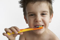 Boy washing teeth Royalty Free Stock Photography