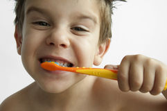 Boy washing teeth Royalty Free Stock Photos