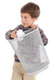 Boy with wastebasket Royalty Free Stock Image