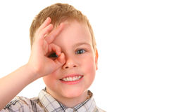 Boy watch through OK gesture Royalty Free Stock Photography