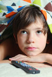 Boy watch tv with remote control Royalty Free Stock Photos