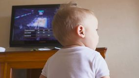 Boy watches television. basketball game. Hd stock footage