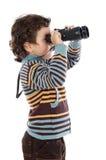 Boy watching after binoculars Stock Photography