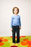 Boy watching bubbles. Portrait of boy staying on colorful carpet watching bubles Royalty Free Stock Image