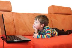 Boy is watching a computer screen Royalty Free Stock Photo