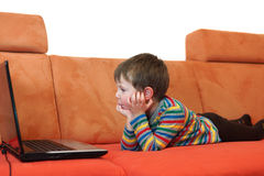 Boy is watching a computer screen Stock Photography