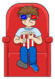 Boy is watching a 3D movie in a cinema Stock Photo
