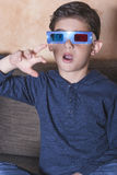 Boy watching a 3D movie stock image