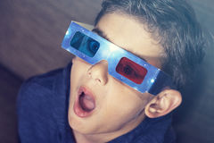 Boy watching a 3D movie Stock Photo