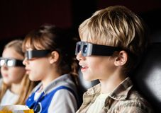 Boy Watching 3D Movie With Siblings Royalty Free Stock Photos