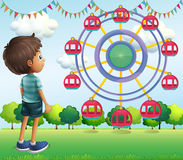 A boy watching the ferris wheels. Illustration of a boy watching the ferris wheels Royalty Free Stock Photo