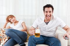 Boy watching football with a beauty, young girl Royalty Free Stock Images