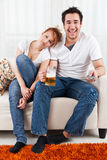 Boy watching football with a beauty, young girl royalty free stock photos