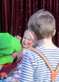 Boy Watching Girl Have Face Painted Royalty Free Stock Photos