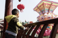 Boy watching lantern fair. Chinese boy watching lantern fair daytime in wuhou temple Chendu Royalty Free Stock Photography